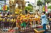 Worshipping at the buddhist Erawan shrine in downtown Bangkok, Thailand, Asia.