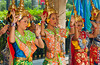 Thai girls perform a traditional buddhist dance at the Erawan shrine in downtown Bangkok, Thailand, Asia.