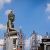 Buddha Surrounded by Construction