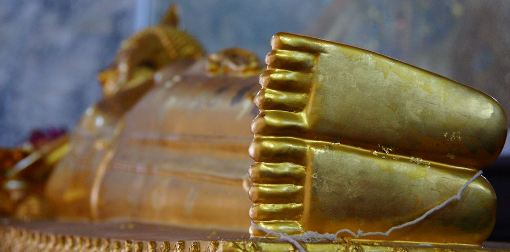Reclining Buddha from the perspective of its feet - Bangkok, Thailand.  This is a photo from Bangkok, Thailand.