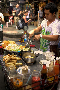 Street food selling Pad Thai on Khao San road in Bangkok, Thailand.  http://www.canvas-of-light.com/2010/11/street-food-thailand/