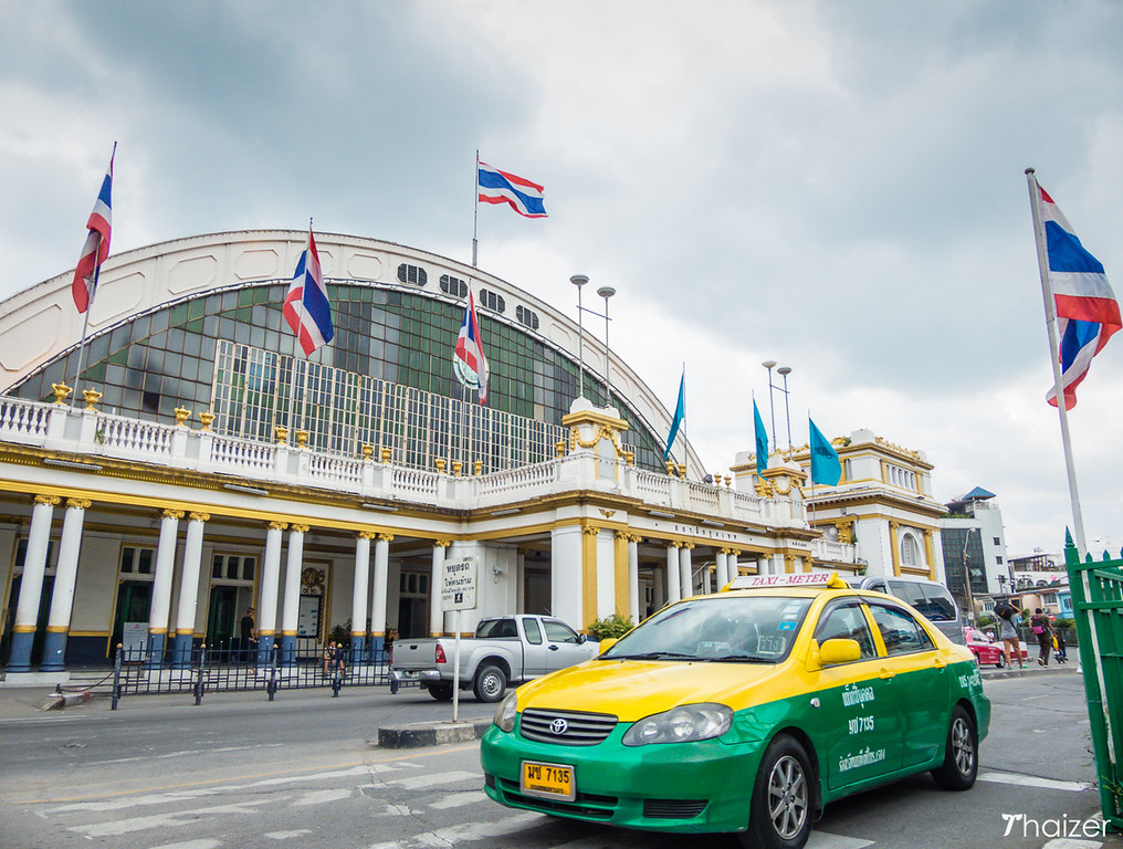 taxi driving in front of Bangkok train station