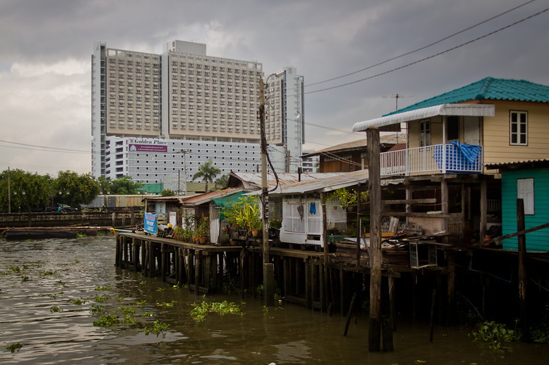 "A Muslim ""village"" inside of Bangkok built on the Chao Phraya river. Many years ago, the King of Thailand offered these houses to Muslims from the South. They would also serve as a first line of defense against warships attempting to invade Bangkok."