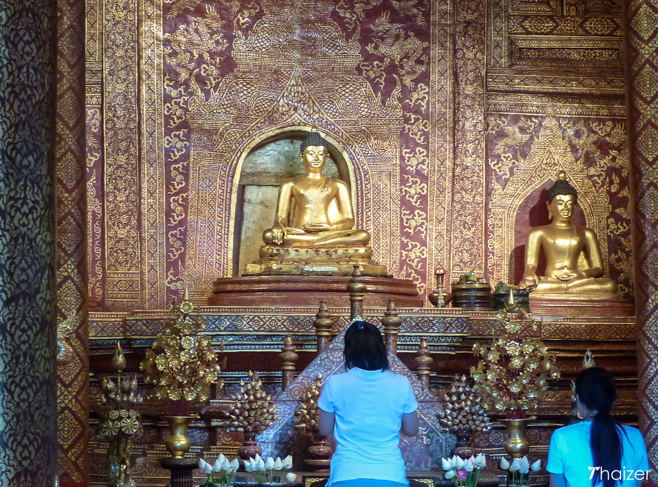 praying to the Phra Singh Buddha image at Wat Phra Singh, Chiang Mai