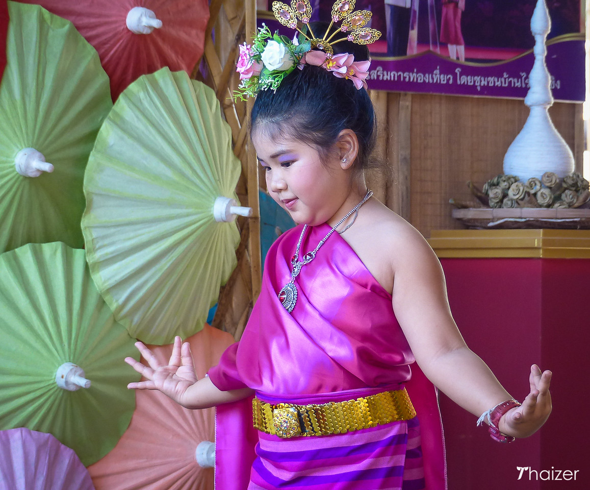 A youngster from the village performs a traditional northern Thai dance