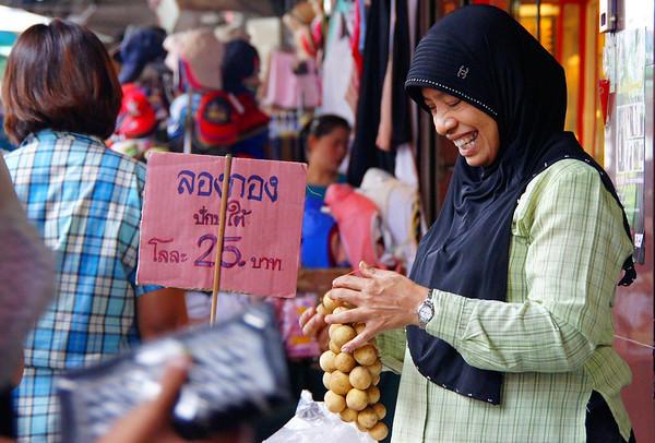 Smiling Thai lady vendor in Chiang Mai, Thailand