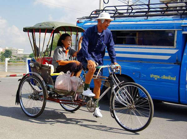 Chiang Mai rickshaw driver on the streets of Chiang Mai, Thailand