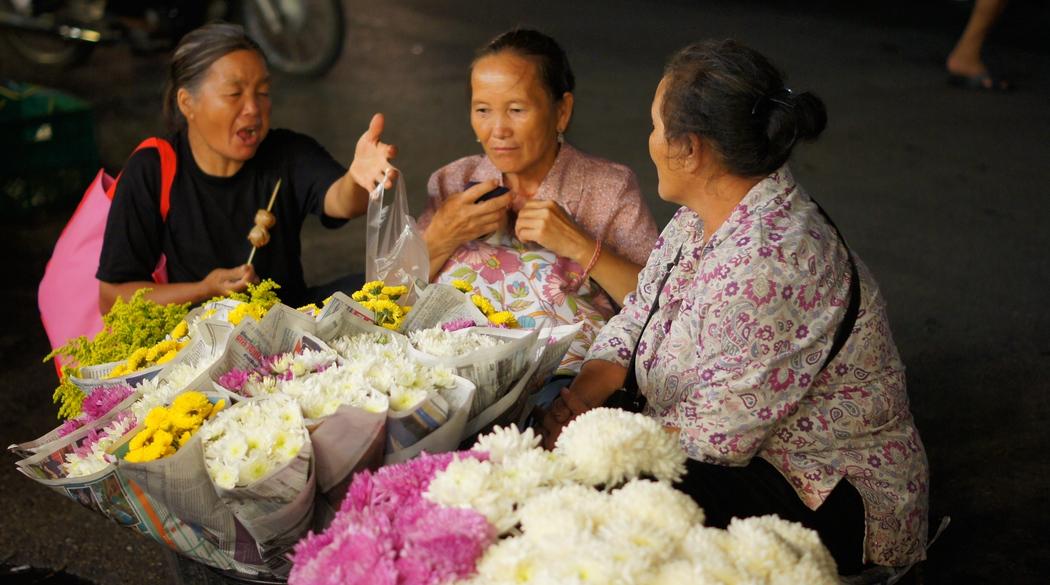 Thai ladies having a candid conversation in Chiang Mai, Thailand