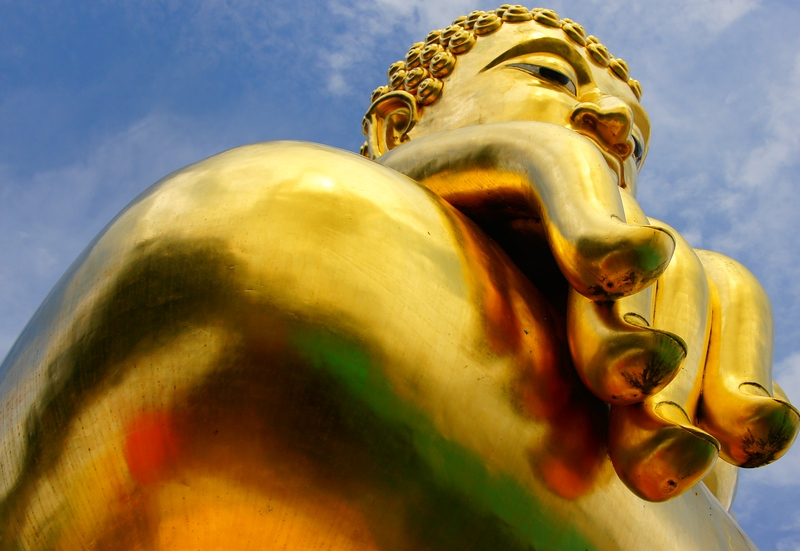 A giant 'golden' Buddha looms large in a remote section nearby the Thai-Laos border