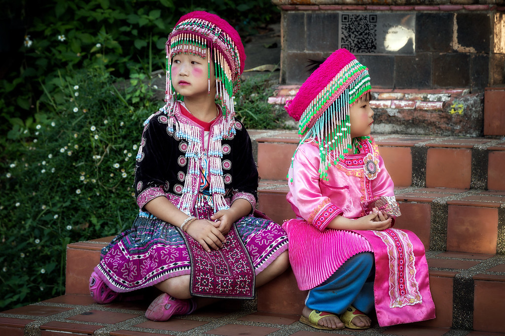 Young Hmong girls sitting on the stairs leading to Wat Phra That Doi Suthep Temple