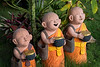 Sculptures of Young Buddhist Monks Holding Alms Bowls
