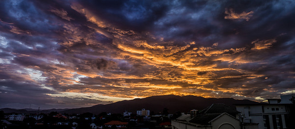 A dramatic sunset over Doi Suthep in Chiang Mai, Thailand.