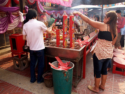 Litghting Joss Sticks (incense) to take in the Temple to pray