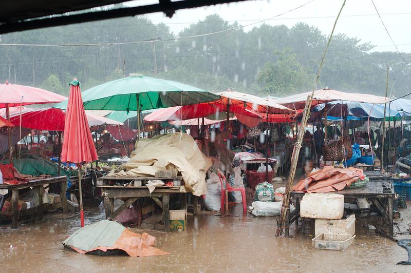 Stuck in the rain at the Doi Muser Market