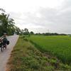 Riding through flat farmland before hitting the mountains