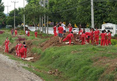 School children working in front of their school