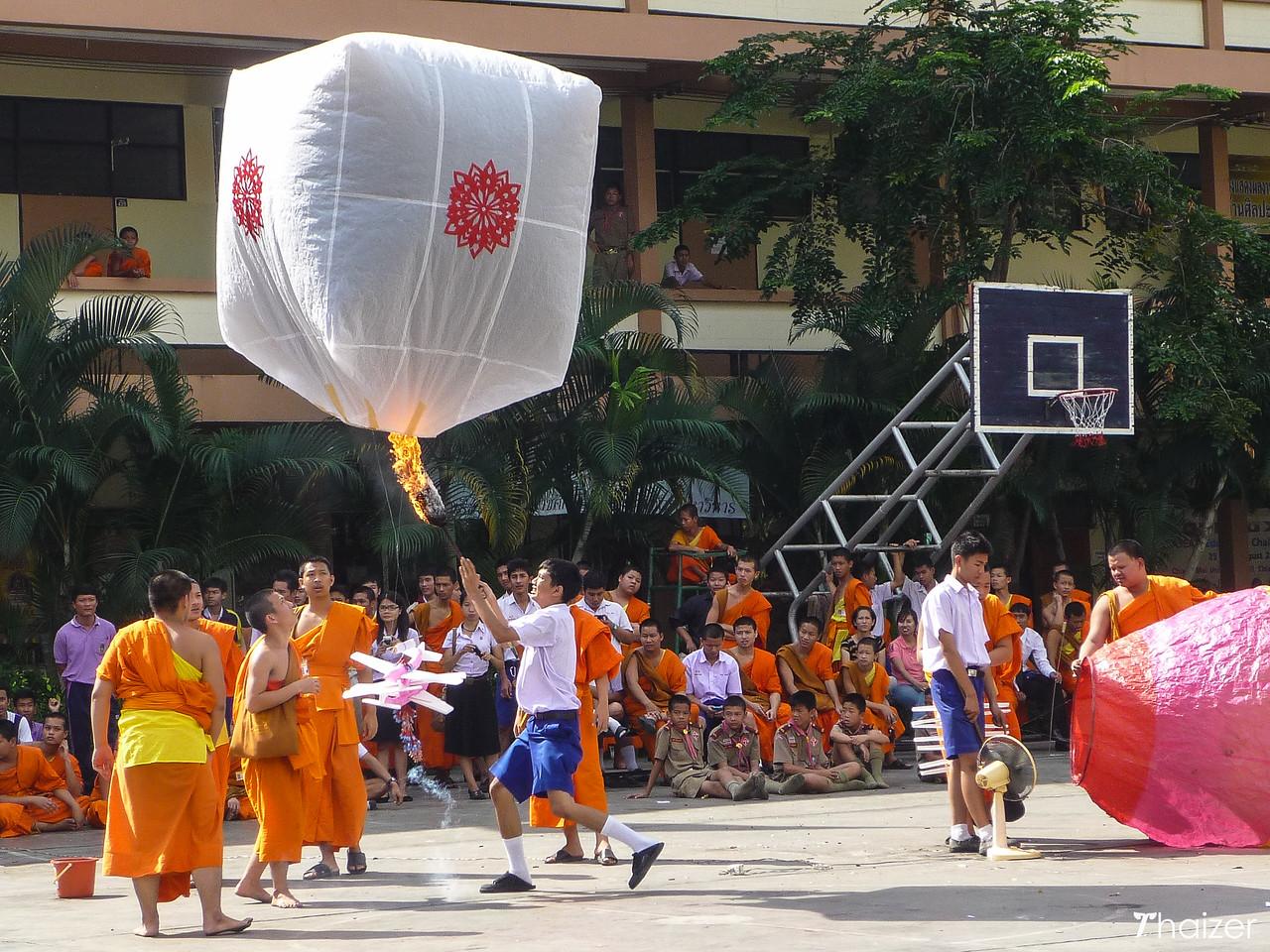 releasing khom fai lanterns during the Yi Peng Festival in Chiang Mai