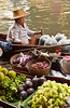 Ladies of the village in small boats sell their produce on the canal in floating markets at Damneon Saduak, Thailand, Asia.