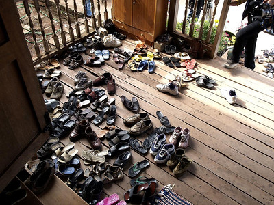 Shoes on the outside of the Shammans house