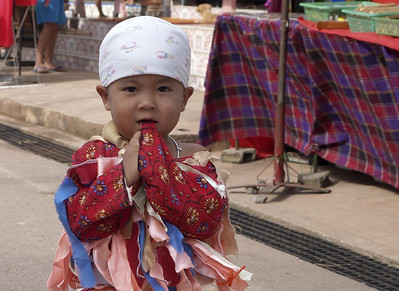 Child dressed for the Ghost Festival in Dan Sai, Thailand