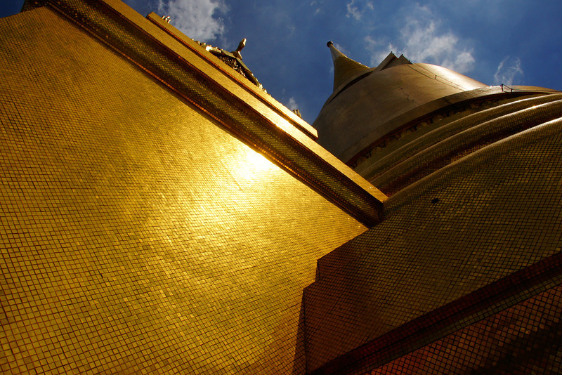"The sun is beaming down on the golden Chedi - Wat Phra Kaew (Bangkok), Thailand.  This is a travel photo from Wat Phra Kaew (Bangkok), Thailand. <a href=""http://nomadicsamuel.com"">http://nomadicsamuel.com</a>"