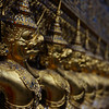 """Ornamented guards spanning the length of the outer wall of the Grand Palace located in Bangkok - Wat Phra Kaew, Thailand.  This is a travel photo from the Grand Palace Wat Phra Kaew.  To purchase this photo click on it or to view the rest of my gallery click here. <a href=""""http://nomadicsamuel.com"""">http://nomadicsamuel.com</a>"""