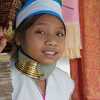 "This cute girl smiling is a member of the ethnic minority hill-tribe group (Long Neck Karen) near Chiang Rai, Thailand.  This is a travel from the hill tribes of Thailand. <a href=""http://nomadicsamuel.com"">http://nomadicsamuel.com</a>"