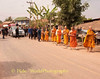 Monks and Novices, Many of them Relatives, Lead the Funeral Procession to the Wat