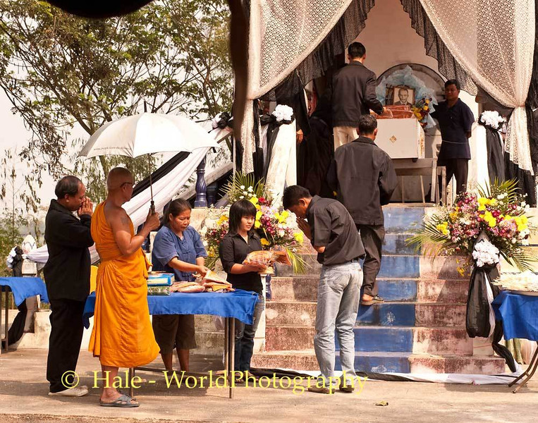 A Villager Accepts Offerings To Bring Up to the Casket