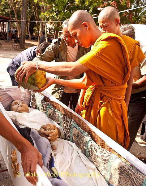 A Monk, A Son, Grandson or Nephew, Pours Coconut Water On the Body