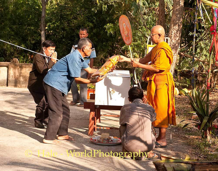 The Abbott Accepts Offerings As Part of the Merit Making Ritual for the Deceased and Participants