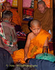 A Grandson, A Novice Monk, Participates In the Ritual Inside the Family Home