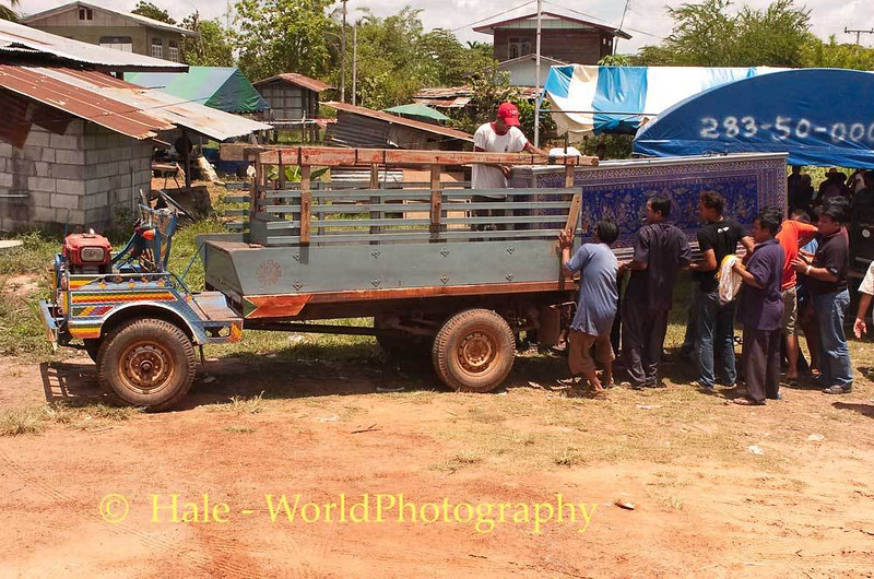 Loading The Casket On Farm Truck to Go To the Local Wat In Baan Tahsang
