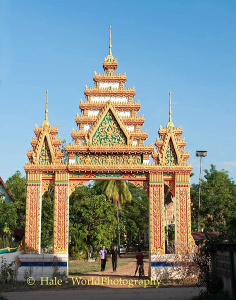 Some Villagers Leave the Wat Grounds Late in the Afternoon