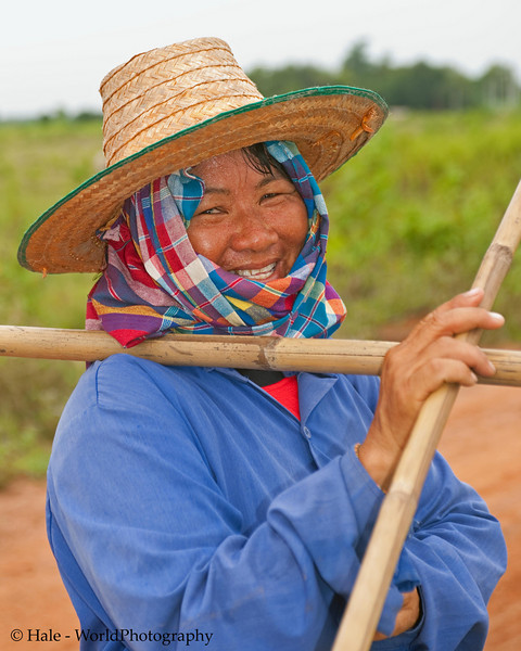 A Passing Lao Loum Cowherder Taking the Time to Smile