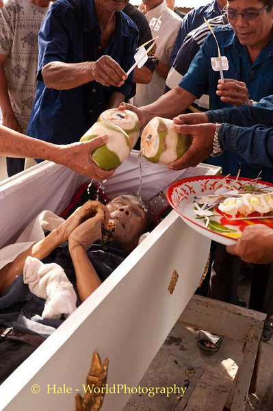 Family Members Pouring Coconut Water On the Body