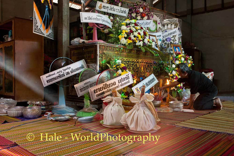 Offerings In Front of Refrigerated Coffin