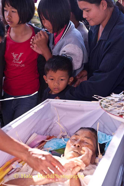 A Young Child Pays His Last Respects