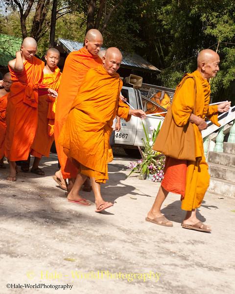 Monks Lead the Procession Around the Crematorium