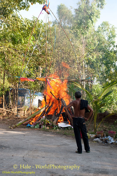 A Brother Tends To The Funeral Pyre