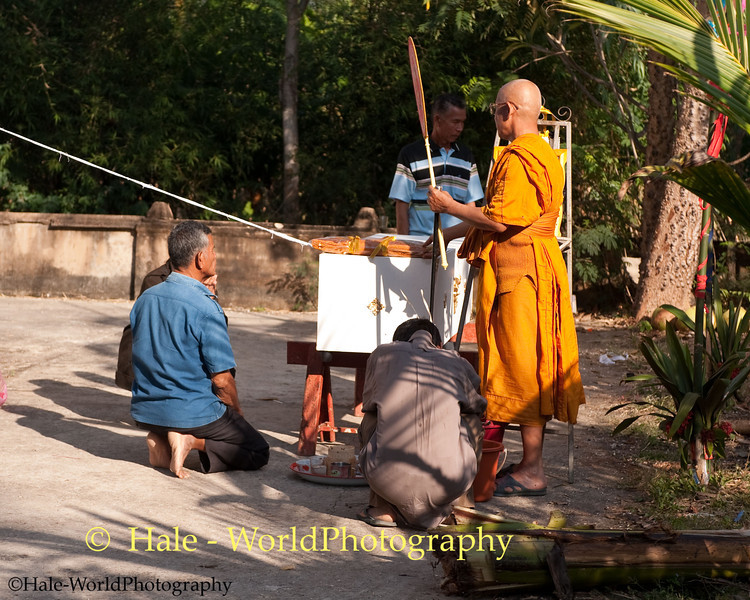 Monk Accepts Offerings