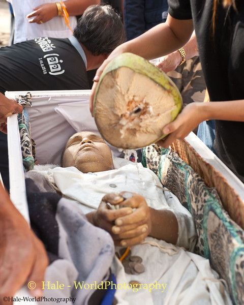 A Friend or Relative Pours Coconut Water On the Corpse