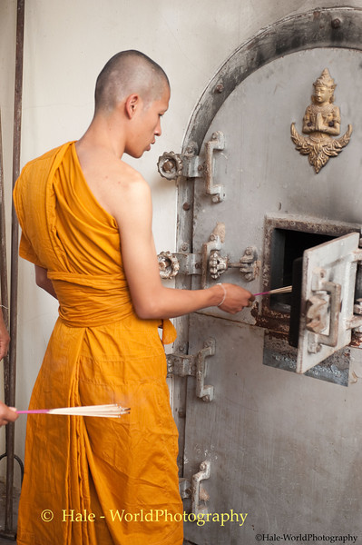 A Monk Ignites the CremationFurnace