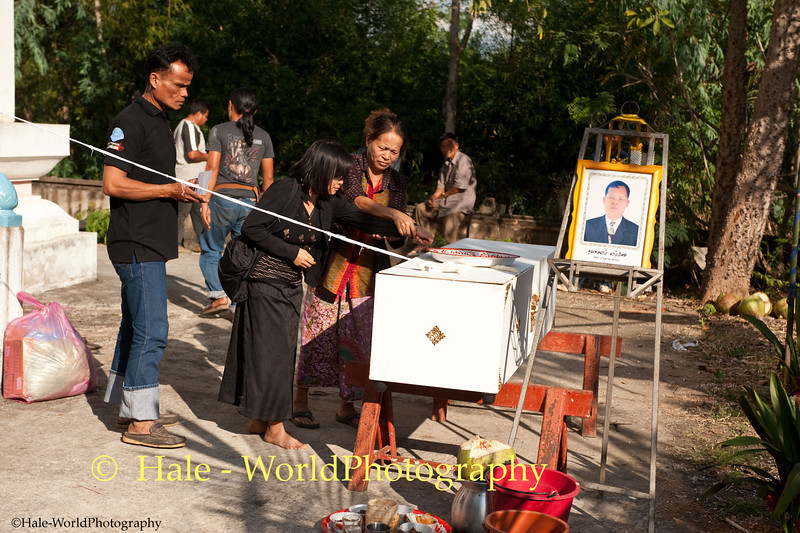 Villager Pays Respect to the Deceased Prior to Making An Offering