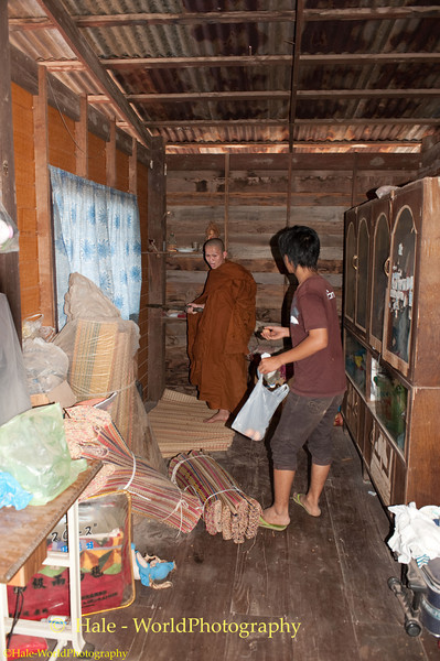 Village Monk Leads and Supervises the Search of a Home for Phii Ling