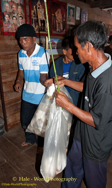 Villager With A Bag of Captured Phii Ling