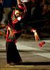 University Student Dancer Warming Up While Awaiting Start of Khao Phansa Night Procession
