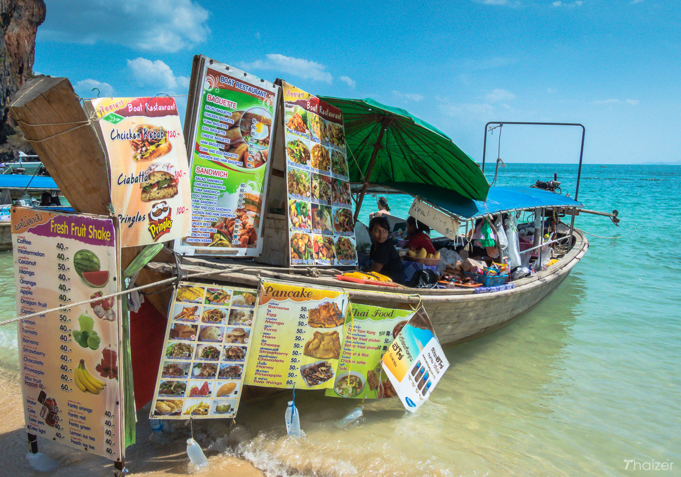 boat vendor at Phra Nang Beach, Krabi