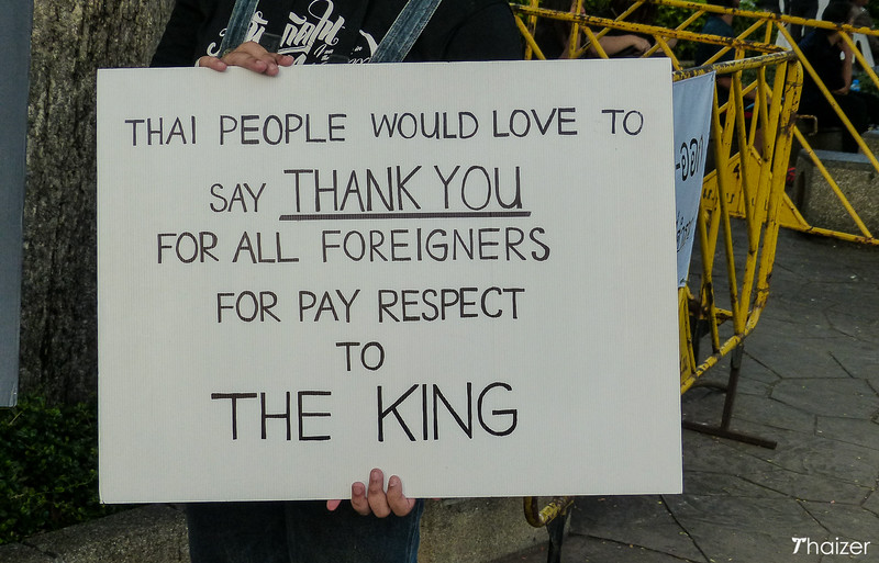 sign held by volunteer outside the Grand Palace, Bangkok