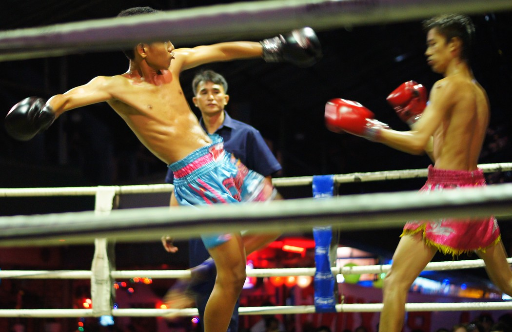 Today's daily travel photo is of a young Thai Muay Thai fighter attempting to kick his opponent in a match - Chiang Mai, Thailand.